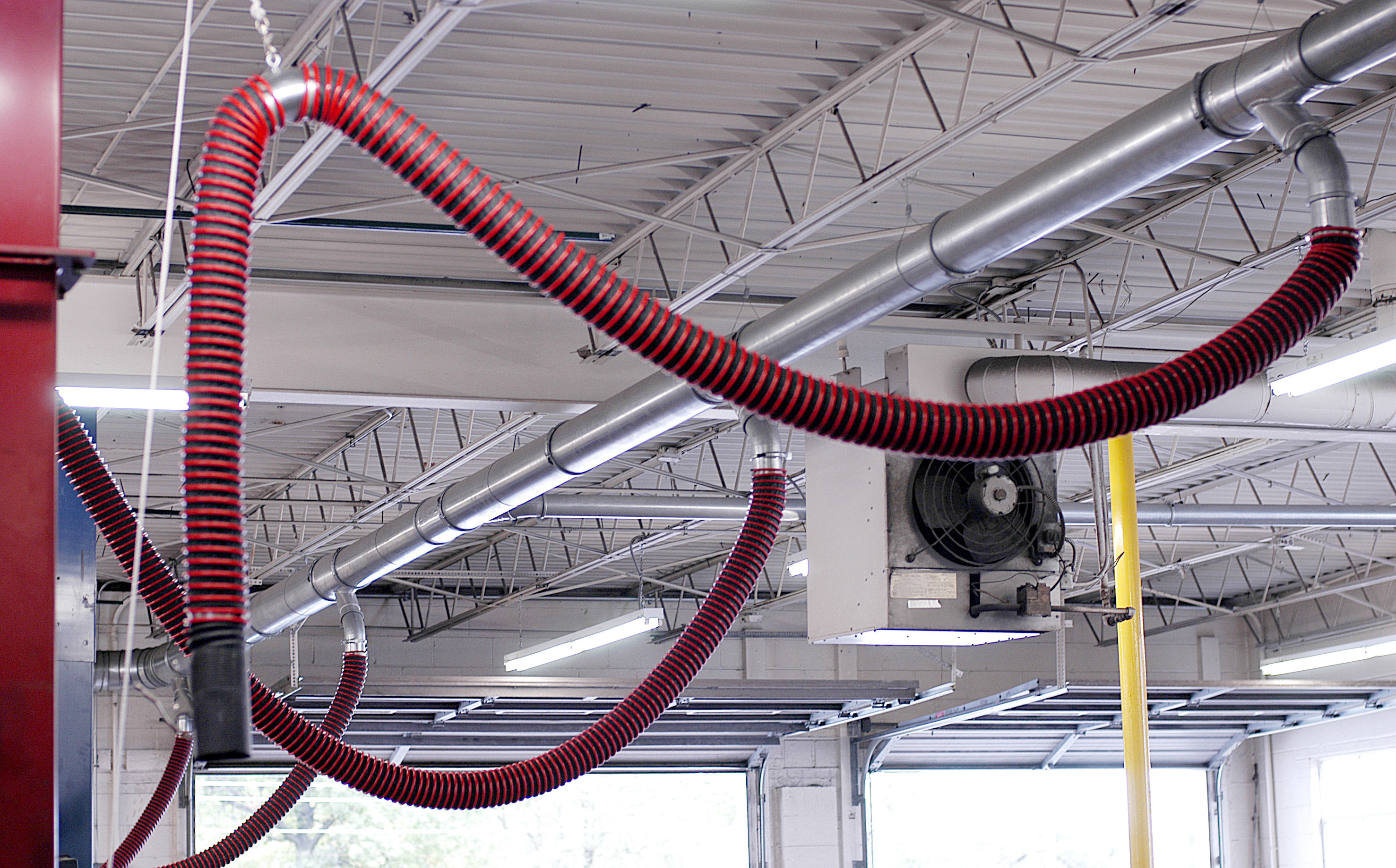 Vehicle exhaust removal systems shown connected to Nordfab Ducting in a maintenance garage.
